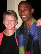 Geofrey Katsushabe and Cari take a moment to show off the Rwandan Scarf for Peace